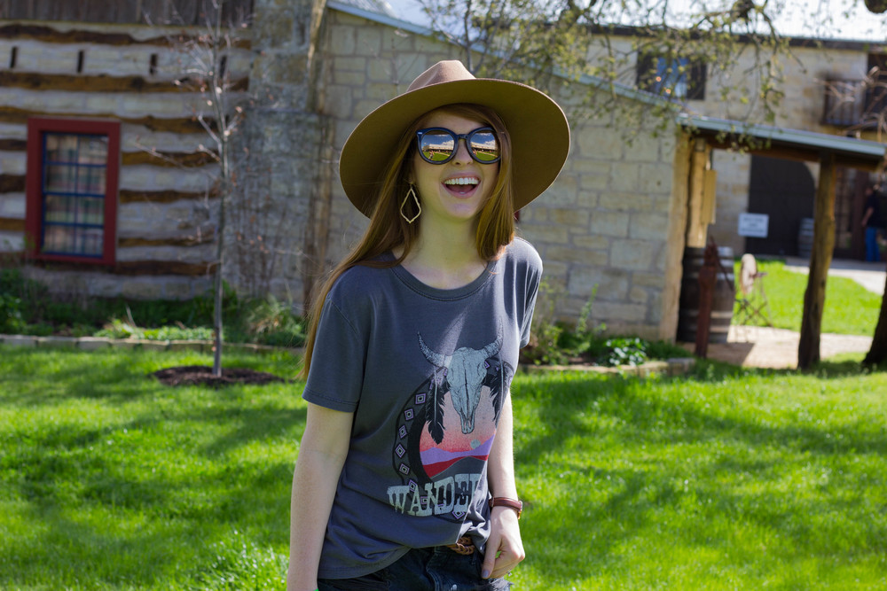 show me your mumu wanderlust tee, one teaspoon black bandits, rebels grey suede booties, karen walker super black and gold sunglasses, kendra scott sophee earrings, fredericksburg, texas, wine country, hill country