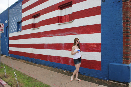 American flag mural, deep ellum, Fourth of July, white strapless top, denim shorts