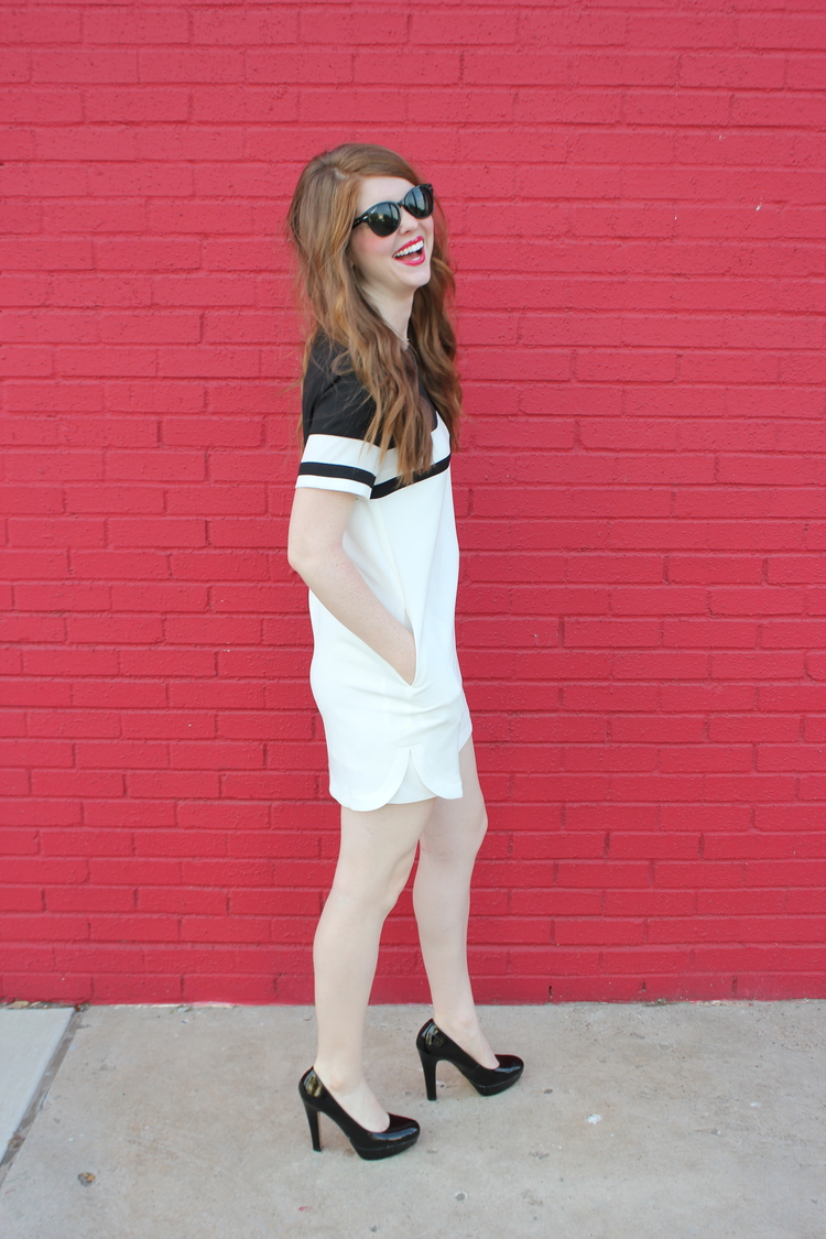 Red lips, Dallas design district, Kendra Scott skylar earrings, red hot background, striped shift dress