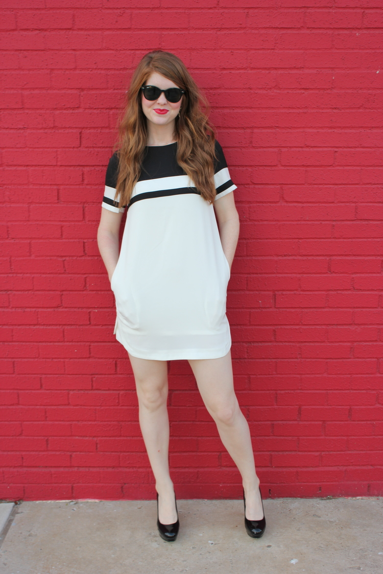 Red lips, Dallas design district, Kendra Scott skylar earrings, red hot background, striped shift dress