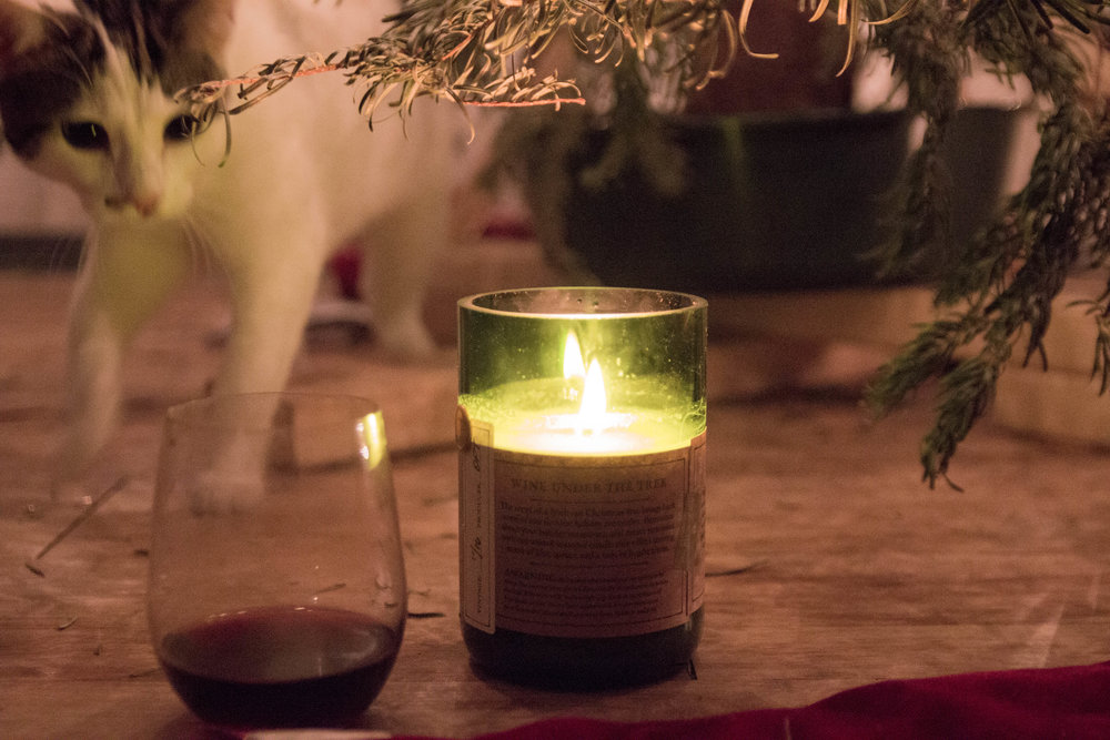 the best holiday candle scents, how to keep that holiday feeling, well after christmas, nest holiday candle, rewined wine under the tree candle, benjamin soap co. pumpkin spice candle
