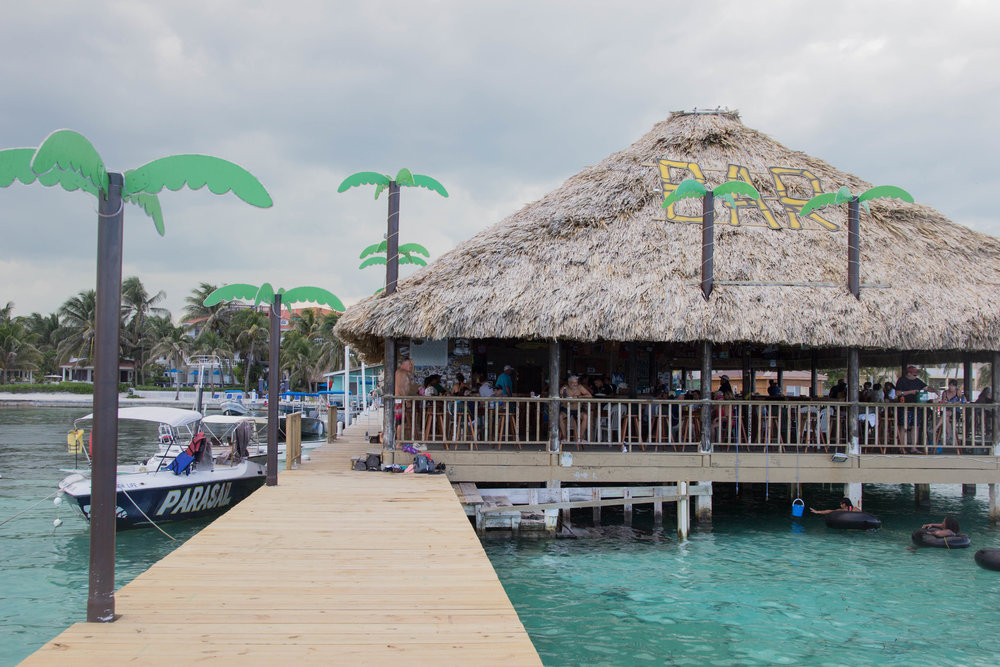 tips for traveling in belize, belize travel guide, ambergris caye, san pedro, what to eat in belize, where to eat in belize, lace midi dress, baublebar mely drop earrings, dolce vita pacer slides, palapa bar