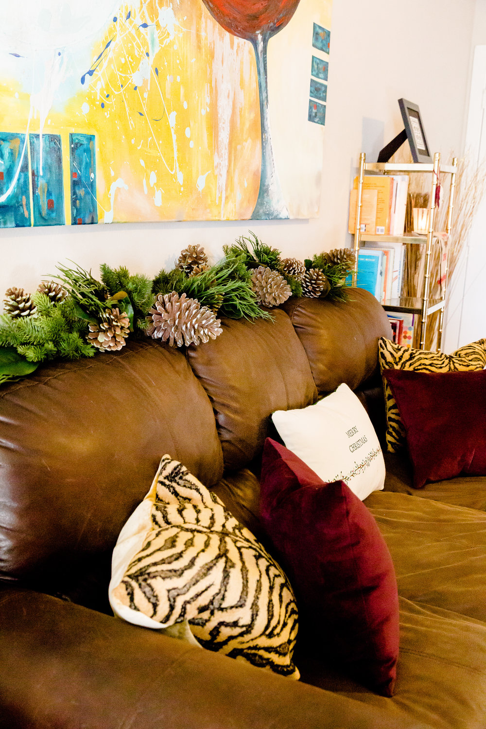 madison katlin photography, christmas central garland, tiger pillows, burgundy velvet pillows, christmas decor, small apartment christmas ideas