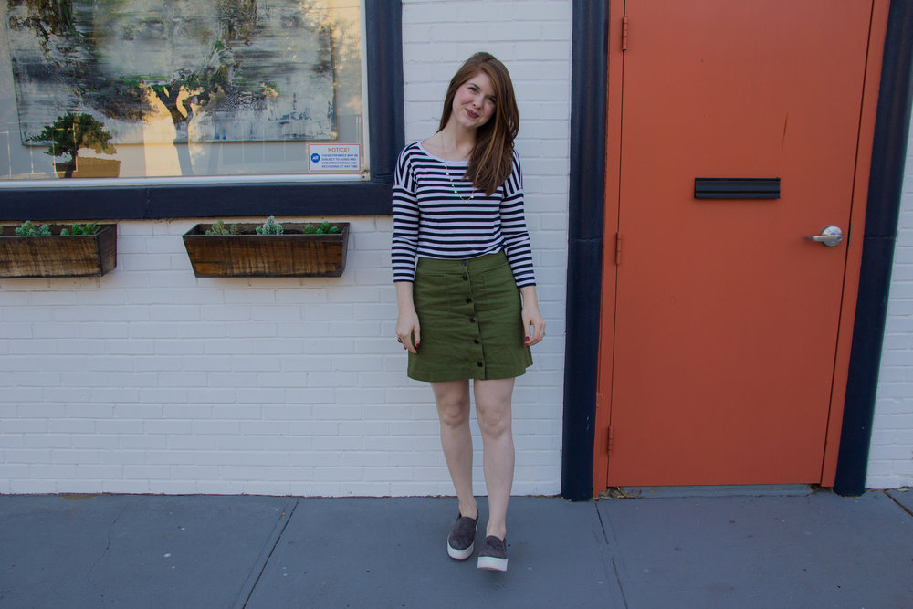 striped loft tee, madewell station mini skirt, kendra scott olive long necklace in gold, lawless soft matte liquid lipstick in brad, vince warren slip on sneaker, the art of versatility, olive button up skirt 3 ways