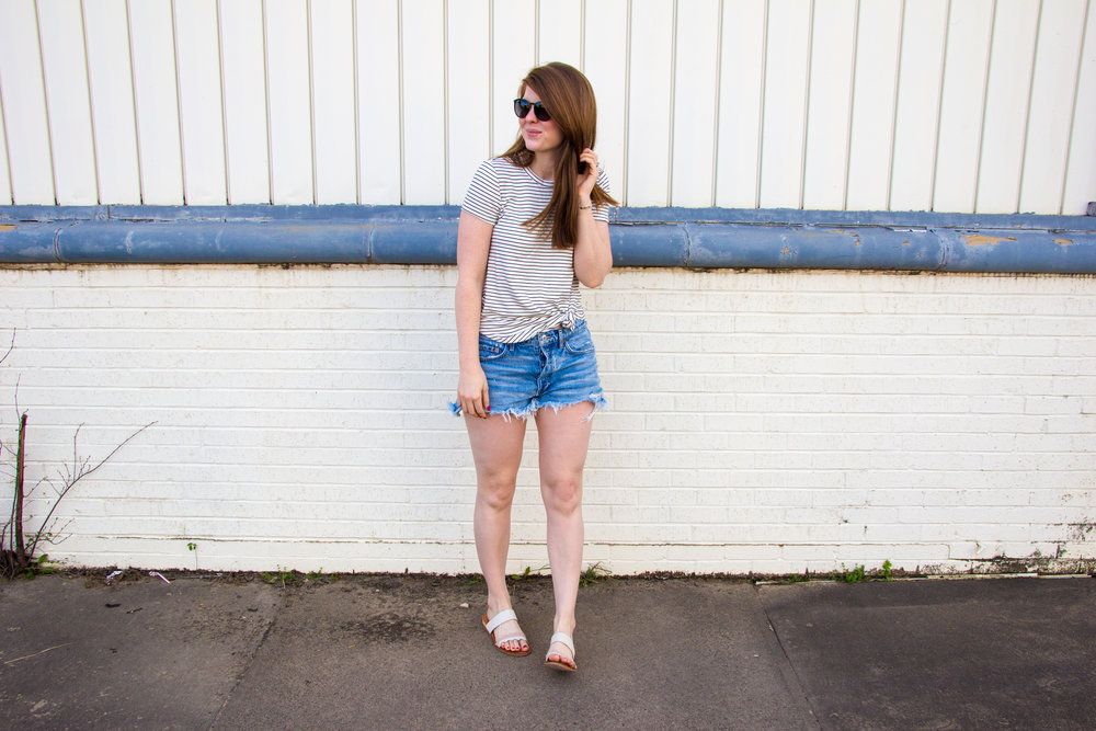 longer denim shorts, agolde parker denim shorts, daily ritual supersoft terry tee, ray-ban erik sunglasses, white slides sandals, 31 bits together bracelet, thirt one bits, denim shorts that are longer than one teaspoon, cut-off jean shorts that aren't too short, shorts that aren't too short