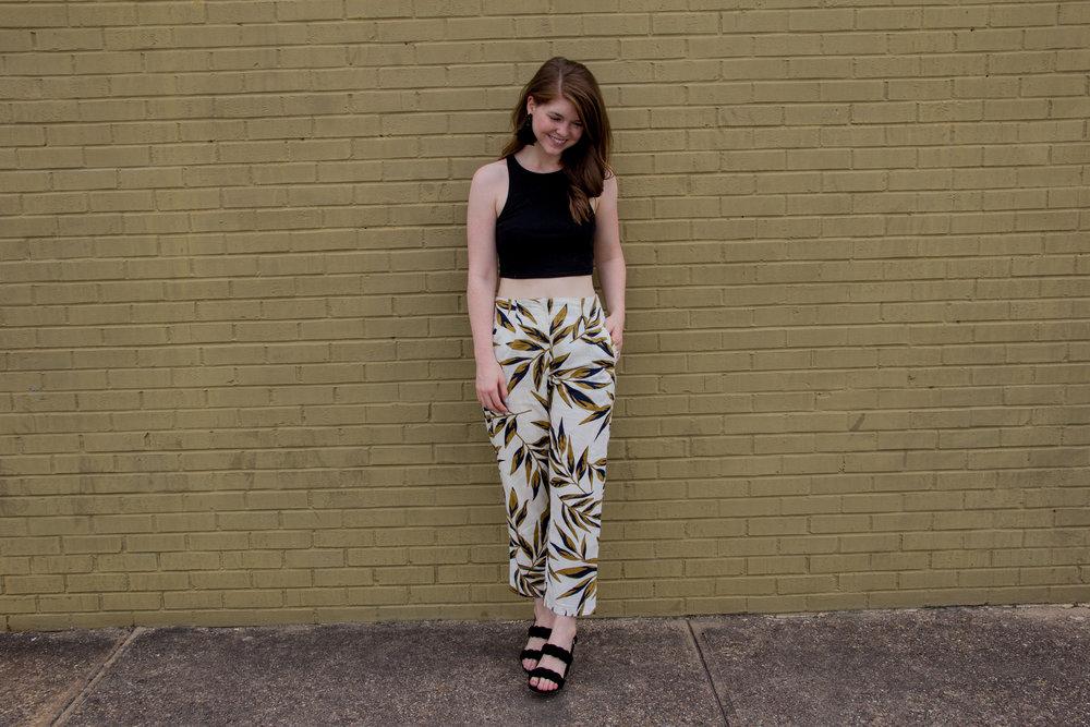 Black Crop Tank | JOA High Waist Pant |Rebecca Minkoff Candace Block Heel Sandals|BaubleBar Parisian Feather Earrings, palm print pants, summer style, lments of style, ellespann