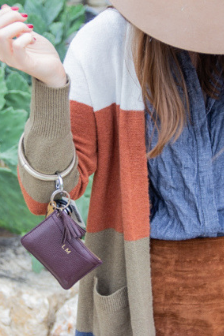 madewell kent cardigan in colorblock stripe, blanknyc suede skirt, italeau booties, central shirt, big o keychain, cuyana cardholder, easy way to hold your keys, keychain bracelet
