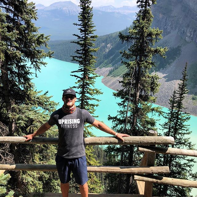 Repping all the way from the Canadian Rockies. Insane view @nottylerpatrick! • #uprising #fitness #onlocation #hiking