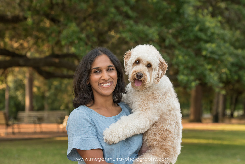 girl holding labradoodle in houston park