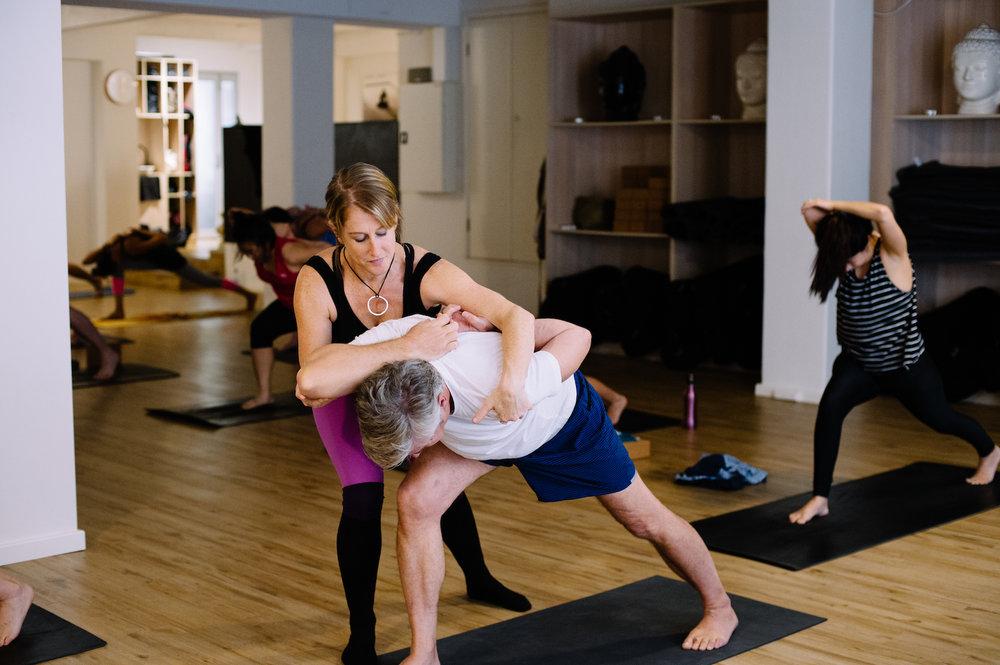 YogaVine Kate Adjusting.jpg