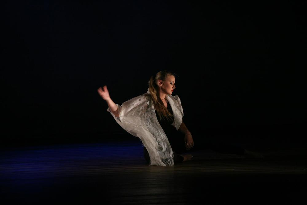 Cas Whiteley performing 'Small Bump'.  Photo by Joanne Black Photography