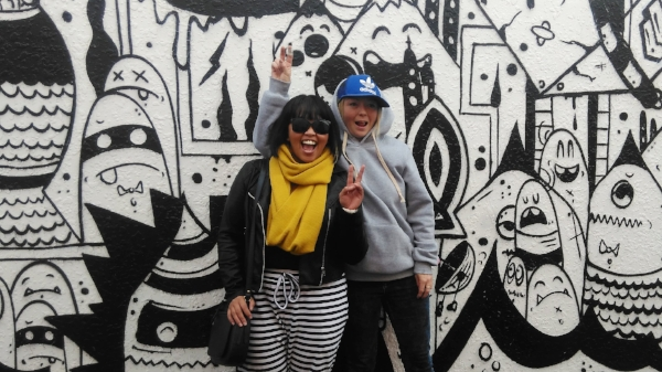 This is my friend Tina and I in Mount Maunganui - there's some really cool street art popping up, and this was just one of them.