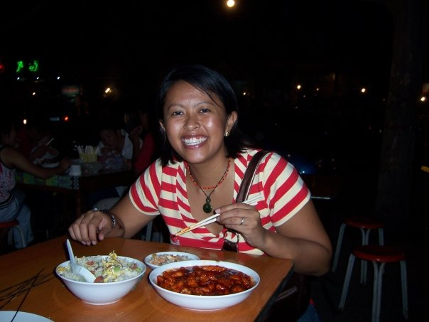 I was 24 years old in this photo, happily eating sweet and sour pork in China in 2007.