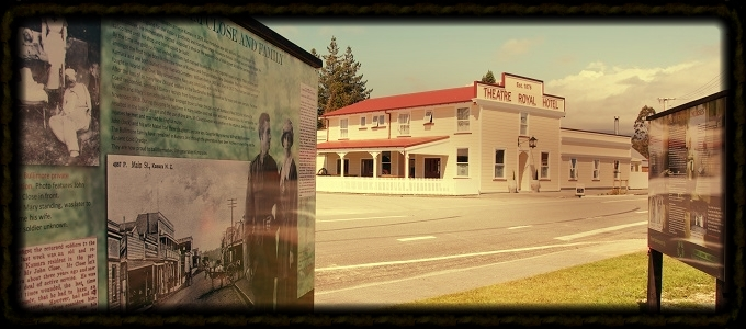 Information panels (foreground) and Theatre Royal Hotel (background), Kumara