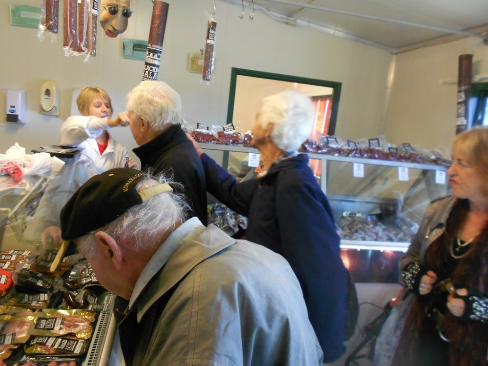 This photo is of some of the Kumara senior group purchasing sausages or salami products from the Blackball salami shop