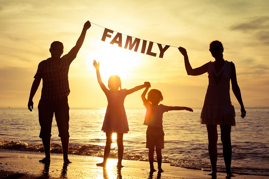 bigstock-Happy-Family-Standing-On-The-B-98845208.jpg