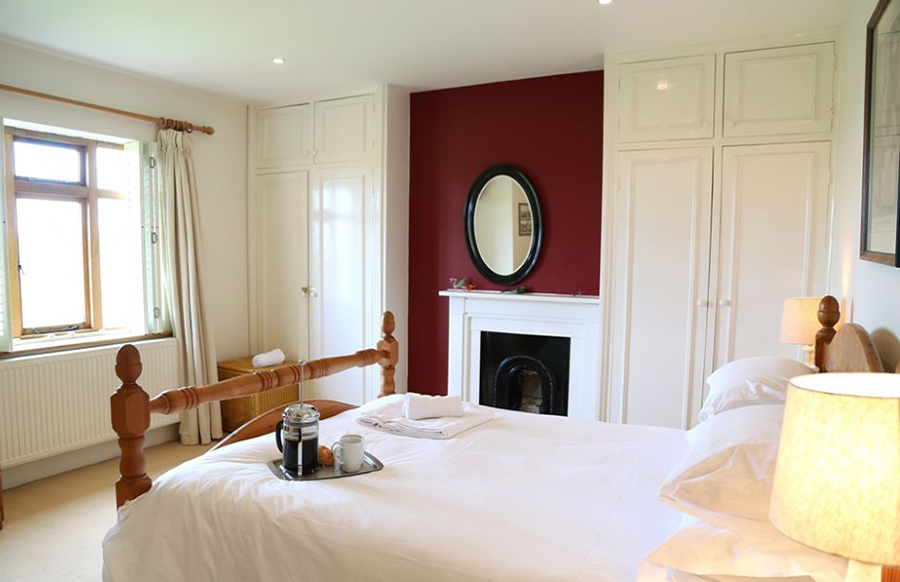 BEDROOM 1 King-sized double bed and en-suite with wc and basin (shared with Bedroom 2)