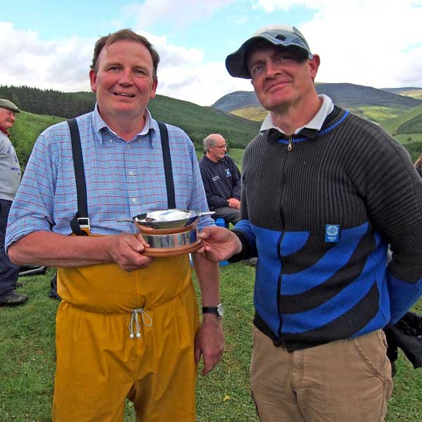 Simon and Angus McLeod (his wind coach) with the David Hossack Memorial Trophy