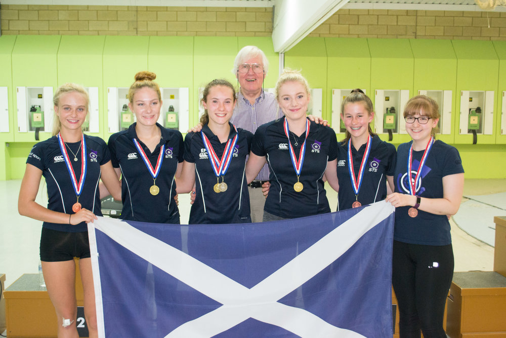 Gold and Bronze Team medallists with coach Hugh Hunter