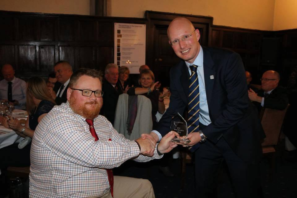 Allan Ritchie receiving one of his two awards at the British Shooting Awards Evening