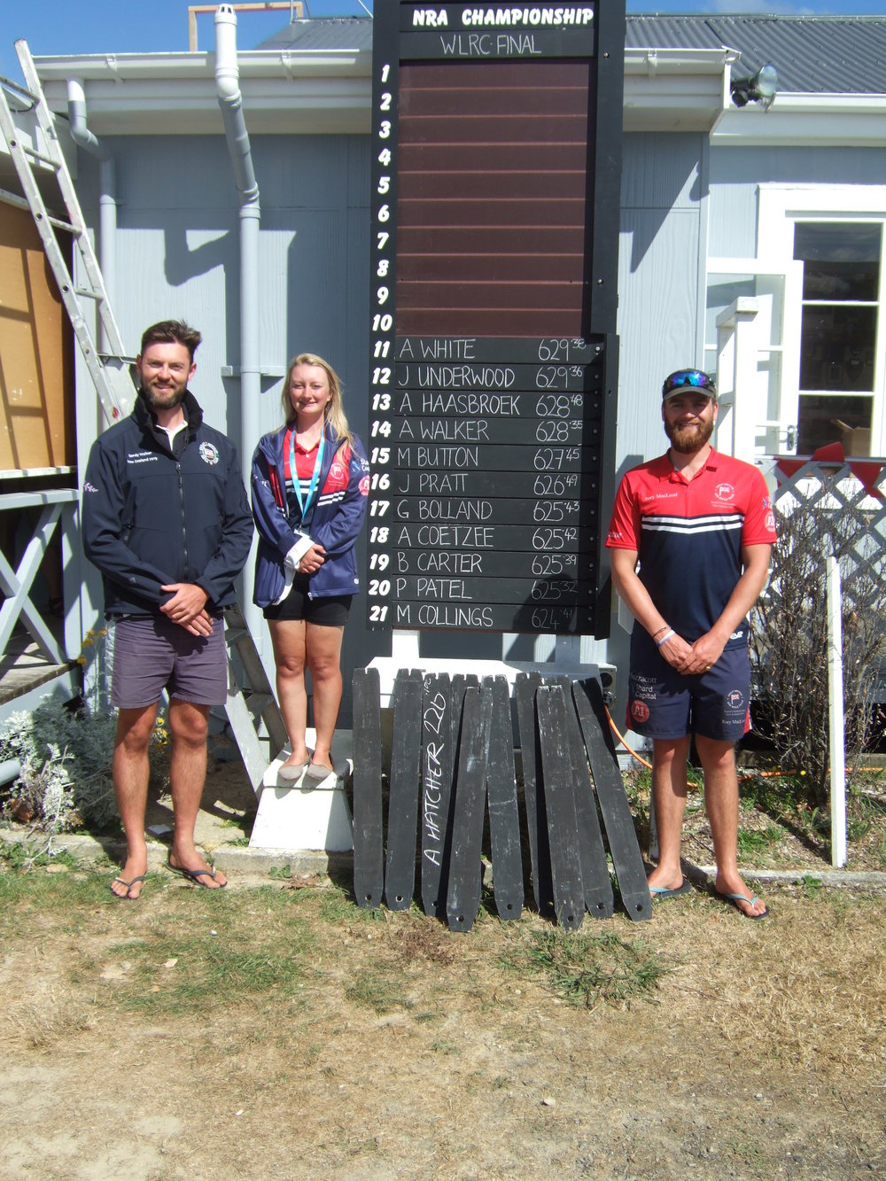Some of the Scottish athletes (L-R Sandy Walker, Lindsey McKerrell and Rory Macleod) next to the World Long Range Championship final score board before the shoot off for the top 10 positions.