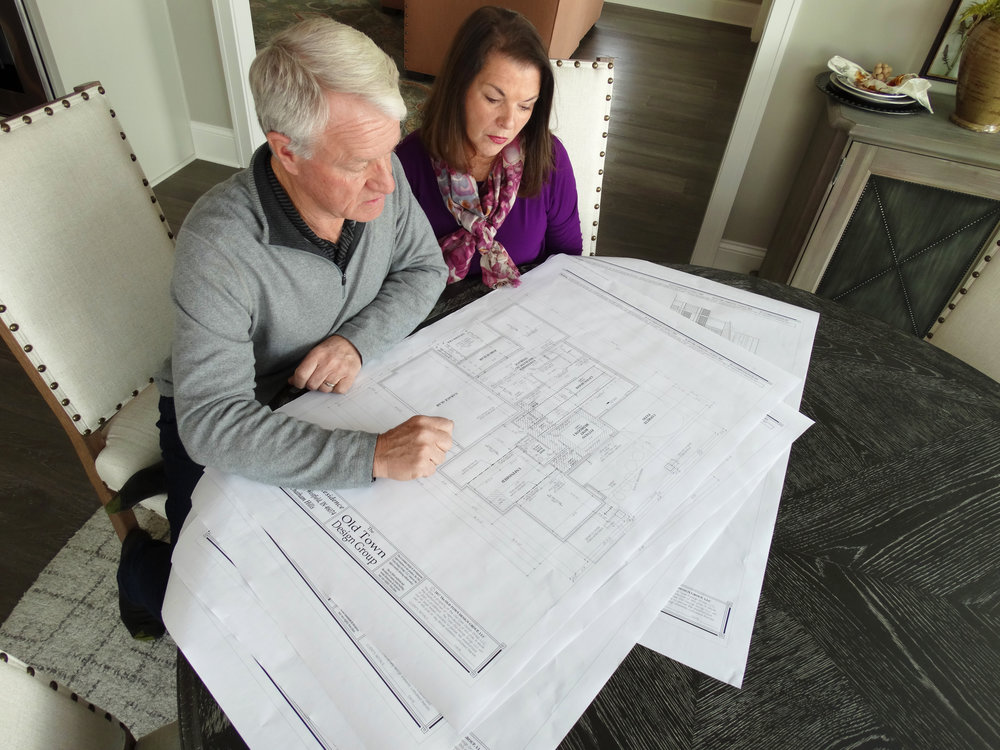 Home owners Jim and Maureen review the final plans of their dream home.