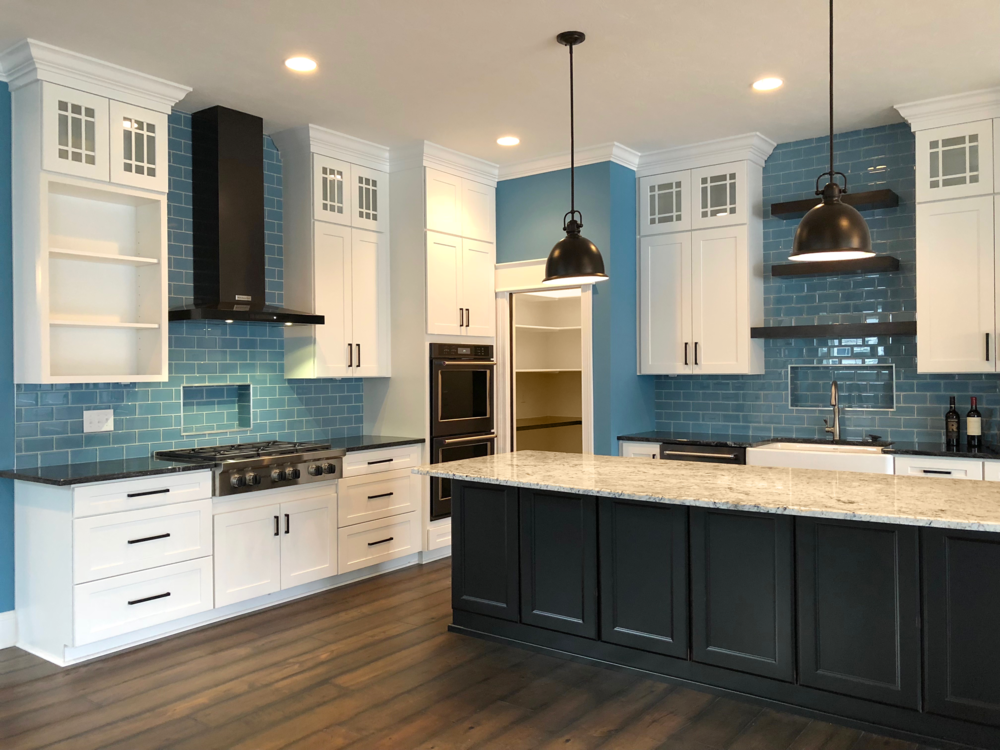 This bright, eye-catching blue tile is a showstopper in this modern kitchen.