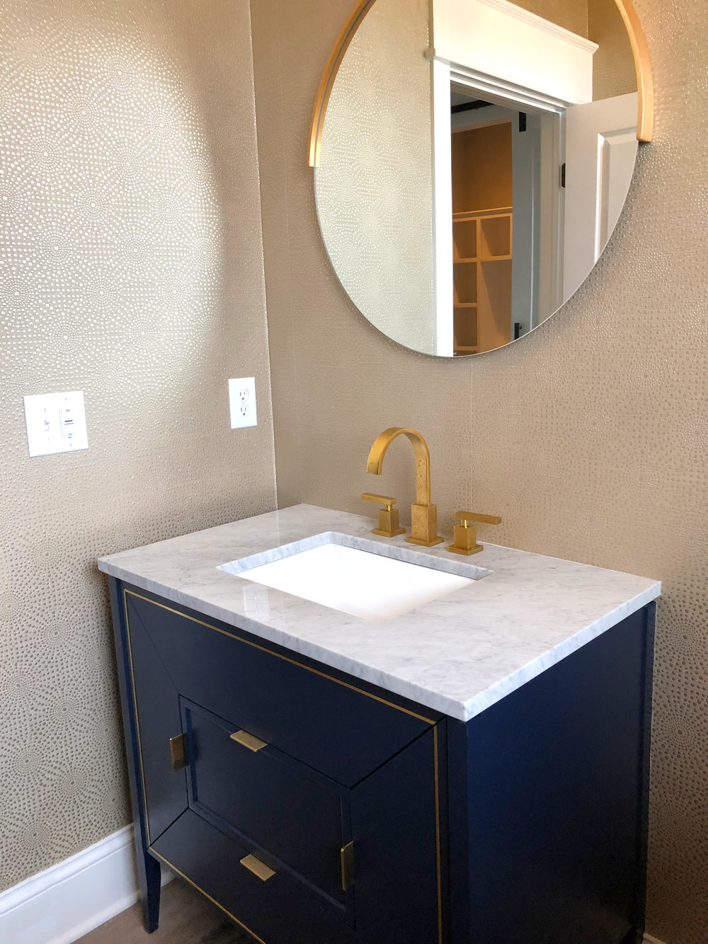 This geometric textured wallpaper is subtle, but brings this powder bath together.