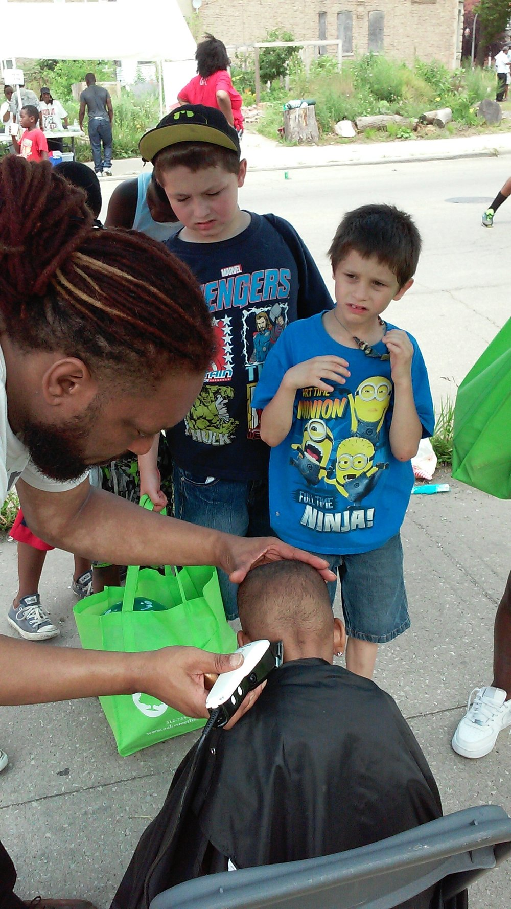 Free haircuts at the  Annual Greater Love Church of God in Christ Back-To-School Street Fair