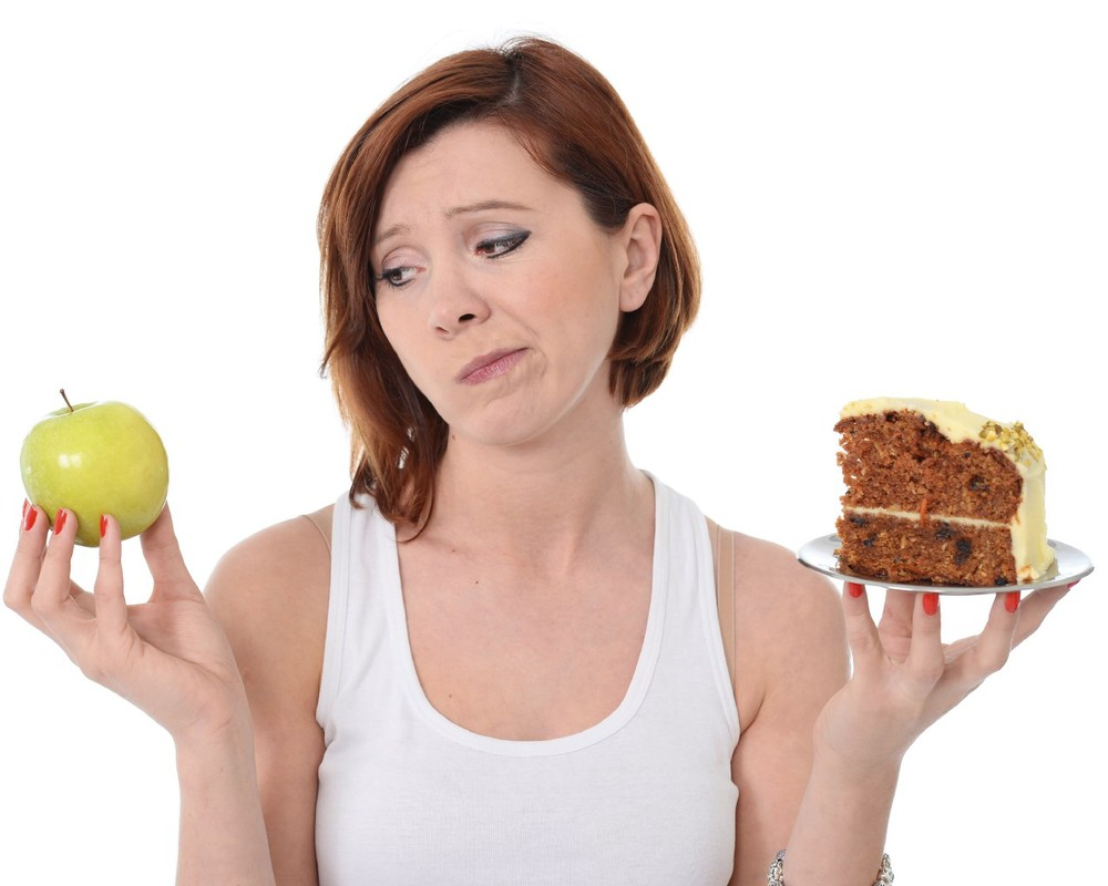 Attractive Woman Dessert Choice Junk Cake Food or healthy Apple