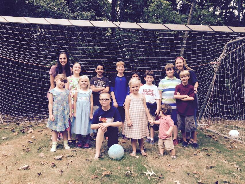 "Some of our Phi Mu ""shadows"" playing soccer with some of our kids."