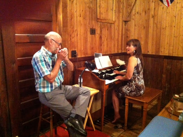 Dave Long and Sherry playing for hymns at Good Sam.