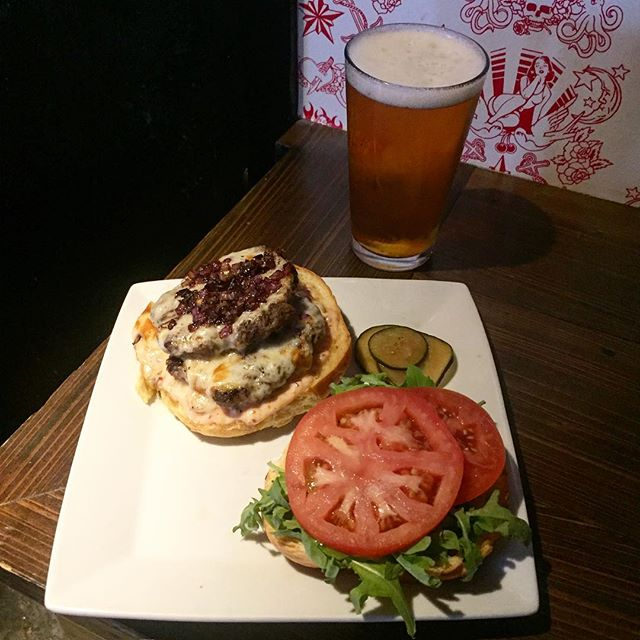 Today's #saturdayburger is legit: double double animal style burger with melted cheese,  grilled onions, and a yummy secret sauce. And see that beer in the background? That's four dollars until 7 pm. #nolaeats #nolahappyhour #comfortfoodwhiskeyrock