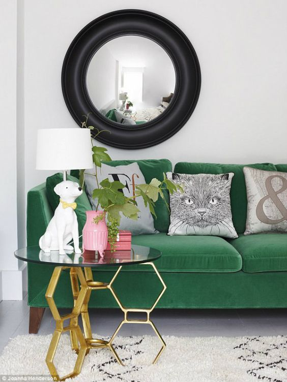 Fun space styling velvet green sofa with quirky animal acessories, stylish Moroccan rug and super glam glass and gold side table  Image:  Joanna Henderson  via  Pinterest