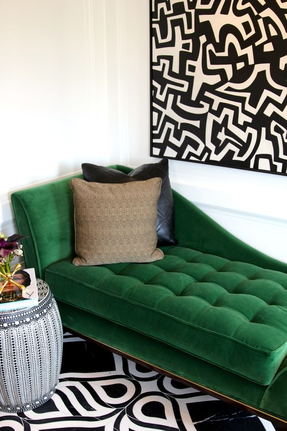 Soft green velvet chaise lounge styled with striking black and white prints and natural hues   Image: Jonathan Alder via  Pinterest