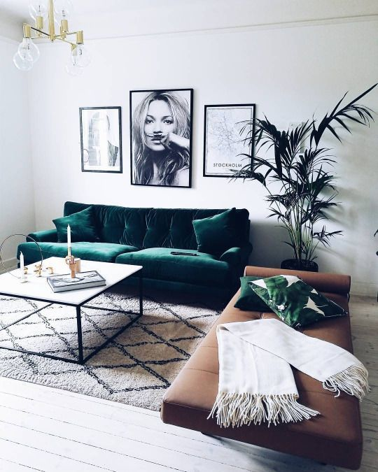 I definitely have a thing for green velvet sofas. Another super cool interior made by the stunning sofa as a feature piece in the room. Styled together with black and white and natural hues and super trendy banana leaf cushion and Morrocan rug.  Image:  Pinterest