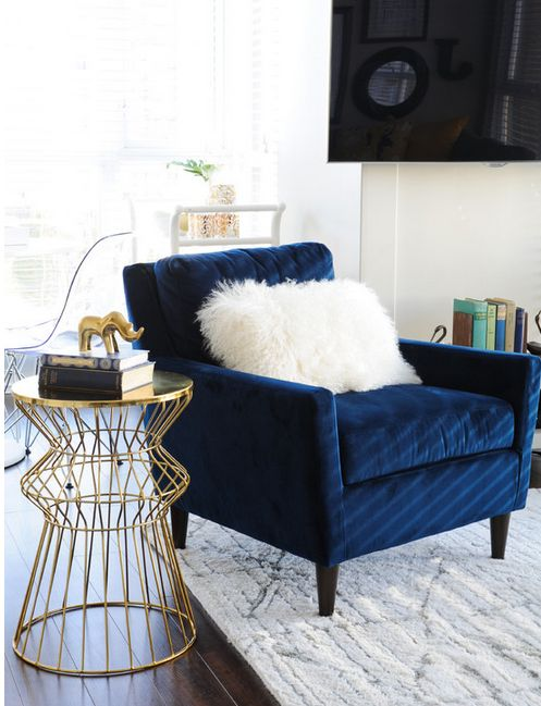 Soft and tactile navy armchair & gold side table up the style stakes | Image: Pinterest