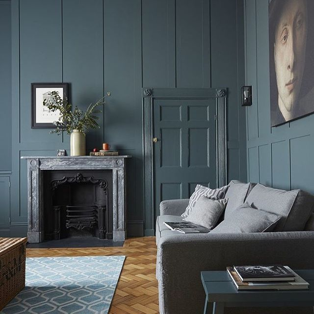 Amazing atmospheric room created by the high ceilings and gorgeous paint selection on the panelling and doorway, moody artwork and refined colour palate👌🏻 #thedesignbug 📸 @livingetcuk . . . #grey #teal #paint #herringbone #livingroom #doorway #panelling #art #fireplace #colour #interiors #interiordesigner #design #decor #interiorinspiration #interiorinspo #inspo #style #homedecor #irishblog #luxeinteriors #interiorblog #interiordecor #interiorstyling #instainteriors #instadecor #instagood #love