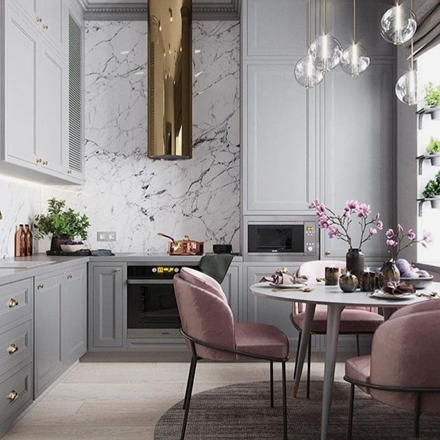 What a stunning kitchen! Love it all and if it were mine I could possibly volunteer to cook dinner each night...or at least keep the cook company seated in one of those fab chairs with a glass of Rosé perhaps...to compliment the delicious colour palate of course! 😋#thedesignbug 📸 @planaspb_com . . . . . . #grey #kitchen #greykitchen #glamour #gold #pink #lighting #blush #marble #colour #colourpalate #interiors #interiordesigner #design #decor #interiorinspiration #interiorinspo #inspo #style #homedecor #irishblog #luxeinteriors #interiorblog #interiordecor #interiorstyling #instainteriors #instadecor #instagood #love