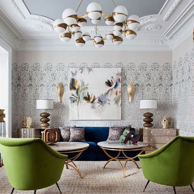Great mix of pattern and plasterwork to create some great friction for the eye. The beautiful feature lighting adds even more drama, optical illusions and geometric shapes to this stunning design. Love the velvet olive green armchairs and inky blue sofa so much!! So much to look at and enjoy! 🙌📸 Pinterest #thedesignbug . . . . . . #livingroom #wallpaper #vintage #glamour #blue #green #midcenturymodern #lighting #pattern #art #colour #interiors #interiordesigner #design #decor #interiorinspiration #interiorinspo #inspo #style #homedecor #irishblog #luxeinteriors #interiorblog #interiordecor #interiorstyling #instainteriors #instadecor #instagood #love