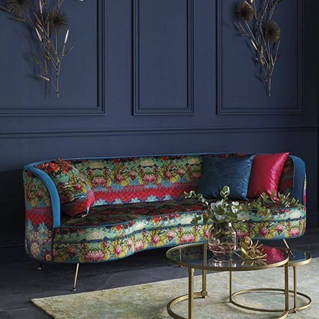 How gorgeous is this? I am loving the Little Palazzo collection of printed and woven velvets by @osborneandlittle. The collection was inspired by Venice and the magnificent palazzi on the Grand Canal constructed in varying styles at different periods of the city's history. Having been proposed to in Venice it will always have a special place in my heart ❤️ The sofa here has been upholstered in Torcello, named after a largely abandoned island in Venice and its truly breath-taking with its chinoiserie style pattern of ornamental floral motifs, scrolling leaves and tresillwork. It looks incredible on this stylish sofa when mixed with Mikado for the sofa border and piping and the beautiful navy paneled wall forming the perfect backdrop ❤️ #thedesignbug . . . . . . #osborneandlittle #sofa #upholstery #fabric #venice #panelling #navy #pattern #floral  #colour #interiors #interiordesigner #design #decor #interiorinspiration #interiorinspo #inspo #style #homedecor #irishblog #luxeinteriors #interiorblog #interiordecor #interiorstyling #instainteriors #instadecor #instagood #love