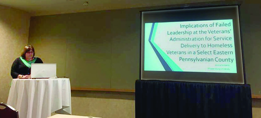 Jessica Schrantz '11-'15M presents her research at a conference in Ohio.