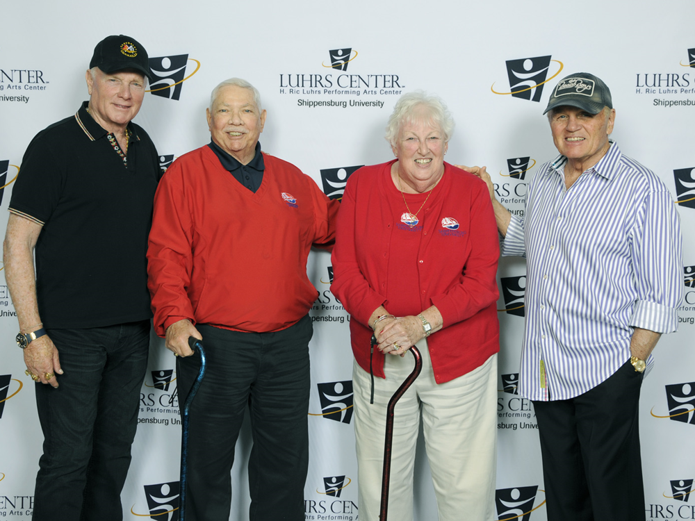 Ron '59–'65M and Kate '60 Conard with Mike Love (left) and Bruce Johnston of the Beach Boys.