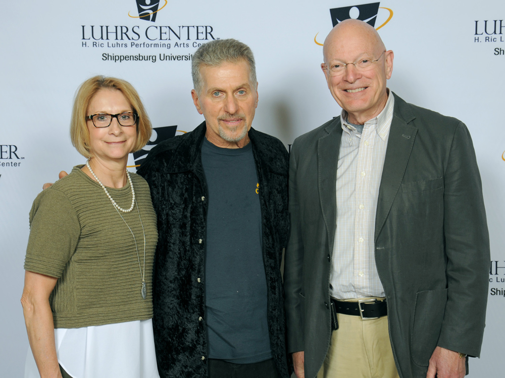 Maxine and William Gindlesperger with Johnny Rivers (center).