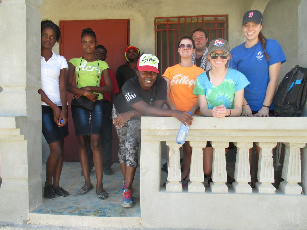 Ship students in Haiti with members of the family of Michael Celius '15, who helped to organize the service trip in Gros Mangles.