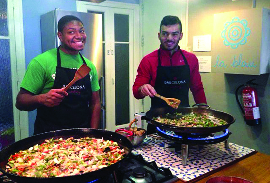 Senior James Landron (left) and Jorge Santiago '16 took local cooking classes while studying abroad in Barcelona.