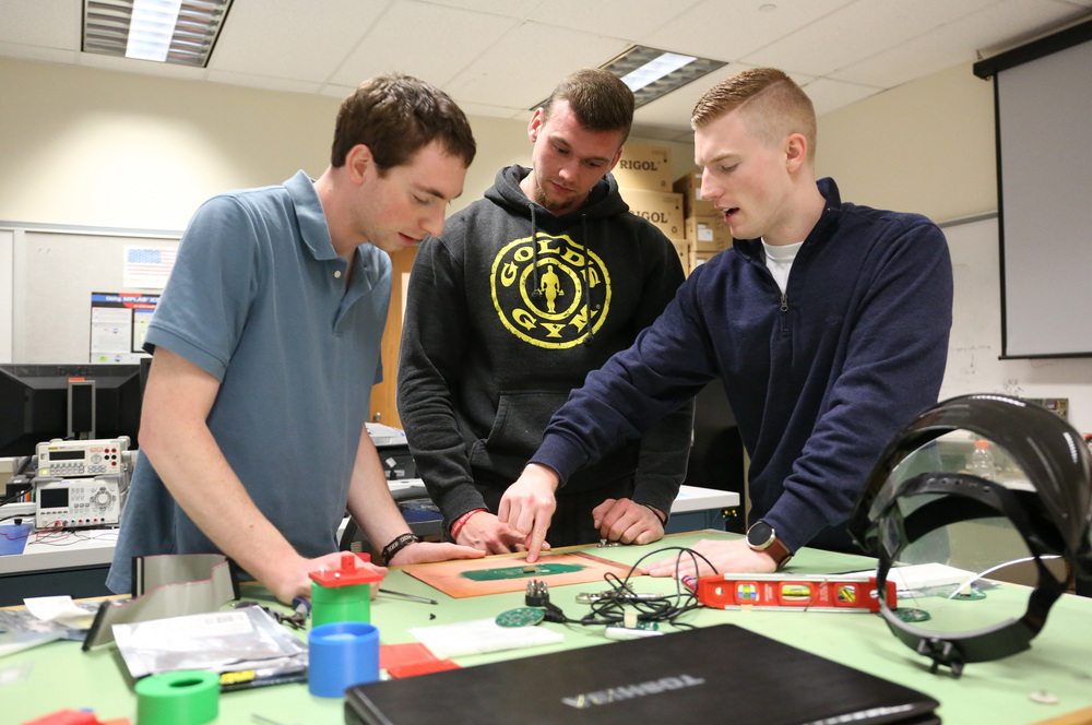 Tyler Garrett '16 (right) designs parts for a research project with classmates Chris Jeffery '16 (left) and David Kinna '16.