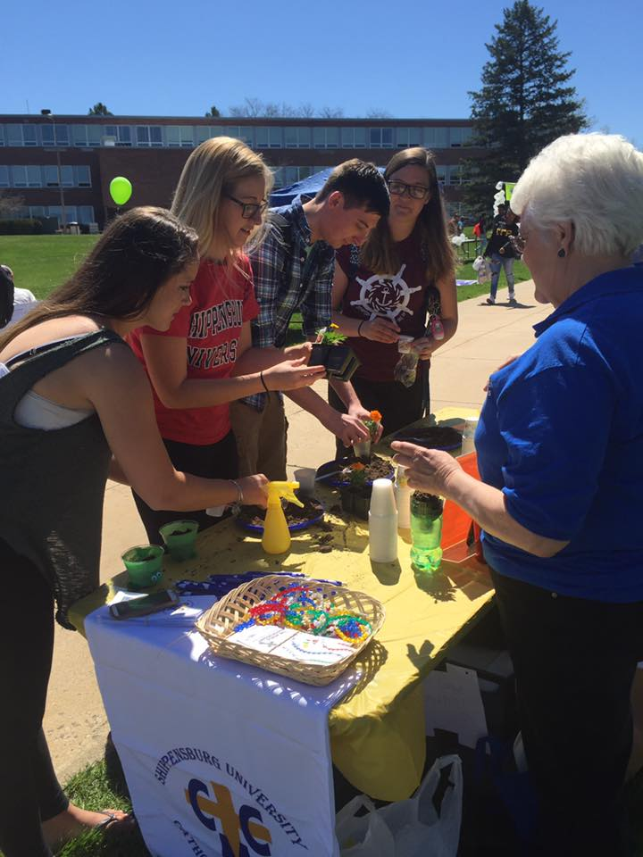 Students plant flowers and lettuce during Earth Day on the quad in April.