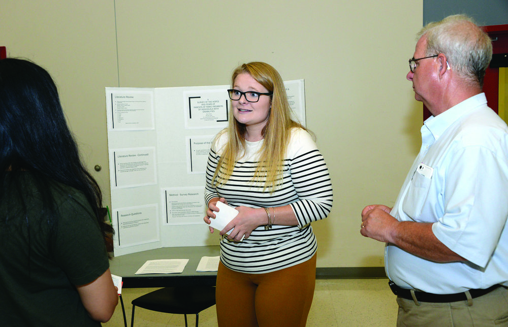Completing a research project with Dr. Chris Schwilk (right) confirmed to senior Alexa Moran (left) that her work could have a meaningful impact on others.