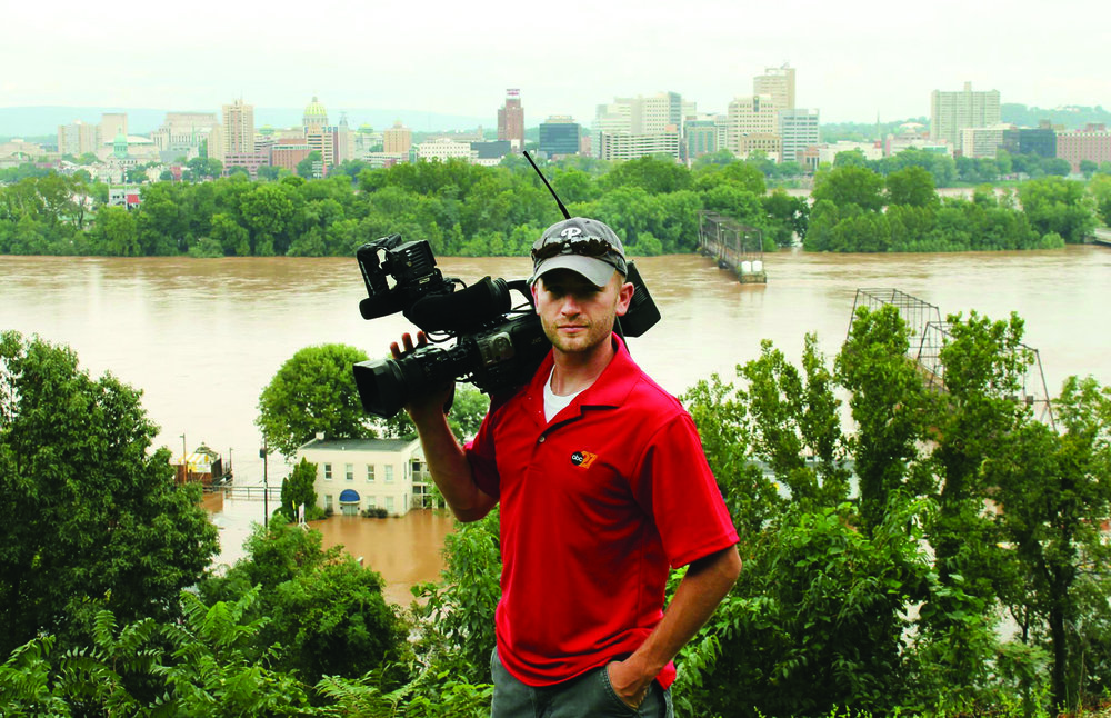 Staging the shot: Eric Heisler '07 on the job while working for ABC27 in Harrisburg as a photojournalist.